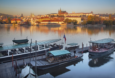 Prague - Charles bridge, castle and cathedral with the little harbor in the morning. Editorial