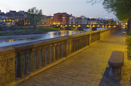 Parma - The Riverside of Parma river at dusk. Stock Photo