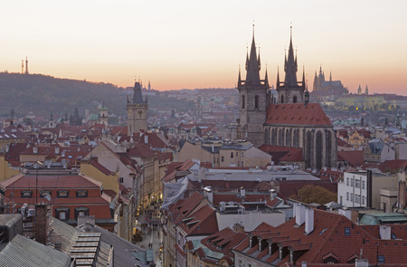 Prague - The City with the Church of Our Lady before Týn and Castle with the Cathedral in the background at dusk. Editorial