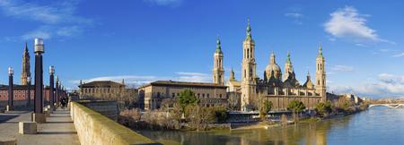 Zaragoza - The panorama of the bridge Puente de Piedra and Basilica del Pilar in the morning light.