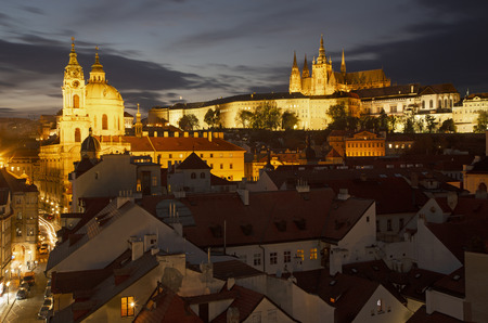 Prague - The St. Nicholas church, Mala strana, Castle and Cathedral at dusk.