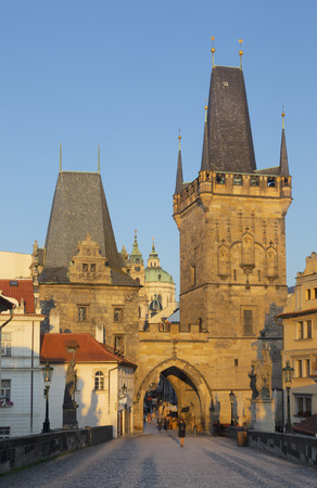 Prague - The gothic west tower of Charles bridge and St. Nicholas church in the morning.