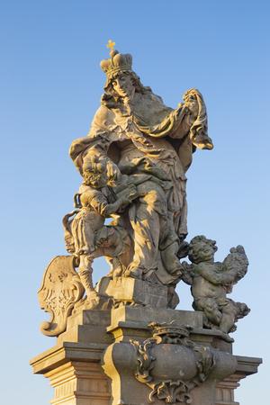 Prague - The baroque statue of St. Ludmila from the Charles bridge by Matthias Braun (around 1730).