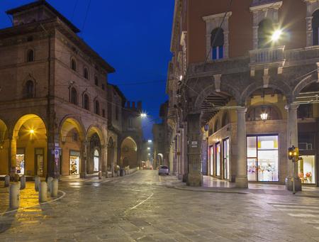 Bologna - The square Piazza della Mercanzia at dusk. Imagens