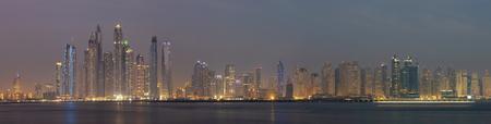 Dubai - The evening panorama of Marina towers from Palm Island.