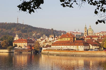 Prague - St. Nicholas church on Mala Strana and Strahov monastery in the background in morning.