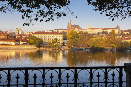 Prague - The Mala Strana, Castle and Cathedral from promenade over the  Vltava river in the morning light. Editorial