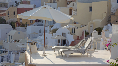 Santorini - The typically little houses and deck-chairs in Oia.
