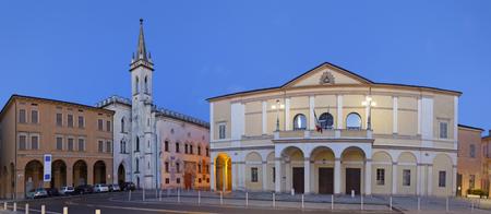 Reggio Emilia - Piazza della Vittoria, Teather Ariosto and Galleria Parmeggiani at dusk.