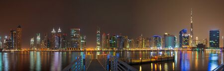 Dubai - The evening skyline over the Canal and Downtown. Imagens