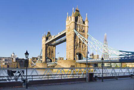 London - The panorama of the Tower bridge, riverside in moring light.