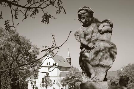 PRAGUE, CZECH REPUBLIC - OCTOBER 14, 2018: The baroque angel before facade of Loreto church  - designed by Kilian Ignac (1772).