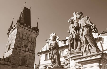 Prague - The baroque staue of st. Cosmos and st. Damian and Christ from Charles bridge by Jan Oldřich Mayer (1666 – 1721).