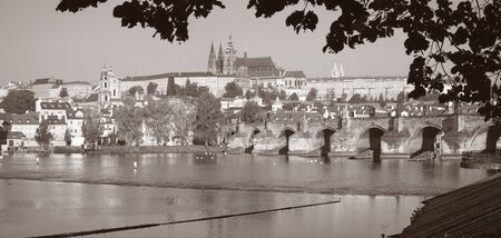 Prague - The Charles Bridge, Castle and Cathedral from promenade over the  Vltava river.