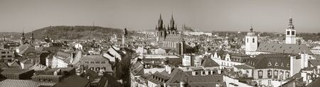 Prague - The panorama of the city with the Charles bridge and the Old Town  in evening light.