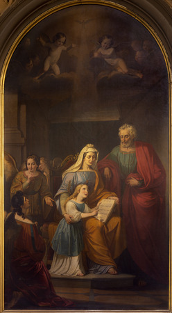 REGGIO EMILIA, ITALY - APRIL 14, 2018: The painting of St. Joachim, little Virgin Mary and st. Ann in church chiesa di San Francesco by unknown artist.