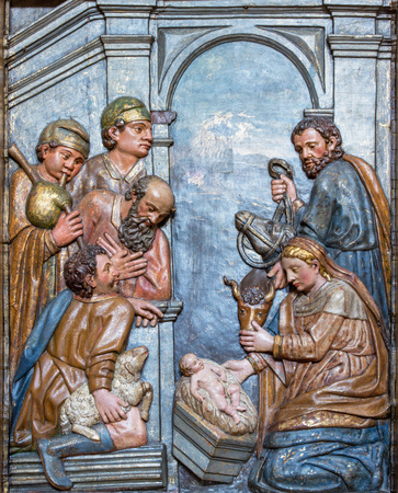 ZARAGOZA, SPAIN - MARCH 3, 2018: The carved polychrome relief of the Adoration of Shepherds on the main altar in church Iglesia de San Gil Abad (1628). Editorial