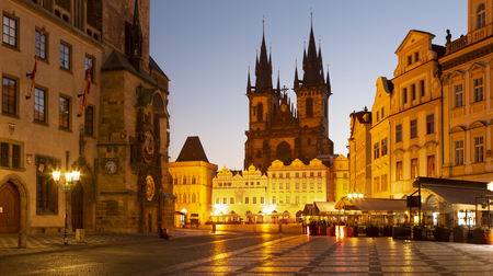 PRAGUE, CZECH REPUBLIC - OCTOBER 16, 2018: The Orloj on the Old Town hall, Staromestske square and Our Lady before Týn church at dusk.
