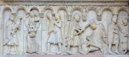 MODENA, ITALY - APRIL 14, 2018: The romanesque relief of Kain and Abel from paradise on the facade of Duomo di Modena. 에디토리얼
