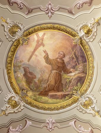 MENAGGIO, ITALY - MAY 8, 2015: The neobaroque fresco of Stigmatization of St. Francis of Assisi in church chiesa di Santo Stefano by Luigi Tagliaferri (1841-1927). Stockfoto - 131860748