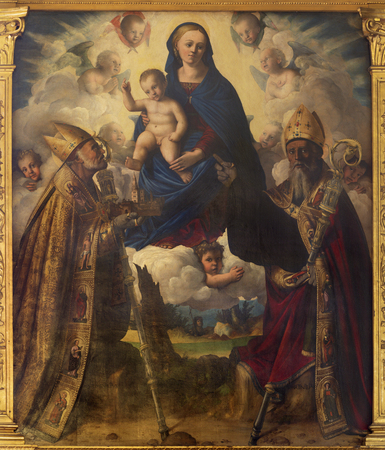 MODENA, ITALY - APRIL 14, 2018: The painting of Madonna with the st. Matin and St. Geminianus in church Abazzia di San Pietro by Filippo da Verona (1520).