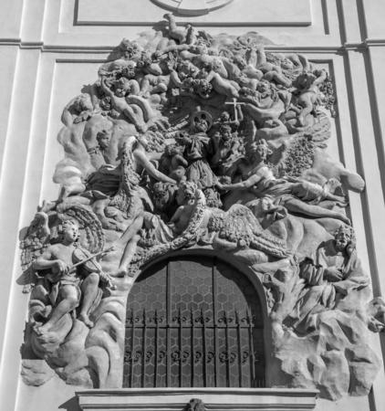 PRAGUE, CZECH REPUBLIC - OCTOBER 18, 2018: Baroque relief of apostle St. Francis of Assisi over the side entry  of  Bazilika Svatého Jakuba Většího (James the Greater) by Ottavio Mosto (1695 -1701). Stockfoto - 131861227