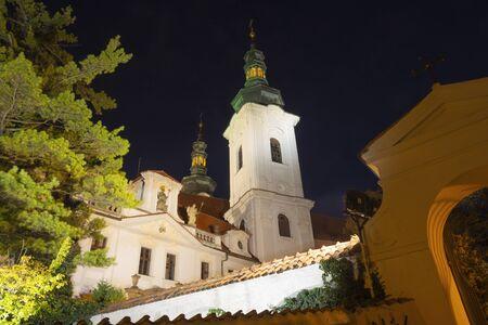 Prague - The facade of Strahov monastery at dusk.