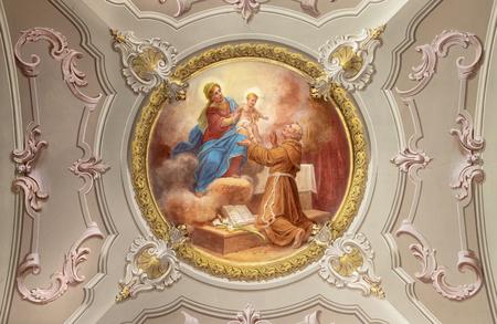 MENAGGIO, ITALY - MAY 8, 2015: The neobaroque fresco of Anthony of Padua in church chiesa di Santo Stefano by Luigi Tagliaferri (1841-1927). Stockfoto - 133113116