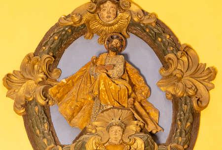 ZARAGOZA, SPAIN - MARCH 3, 2018: The polychome carved renaissance relief of St. Mark the Evangelist in church Iglesia de San Miguel de los Navarros.