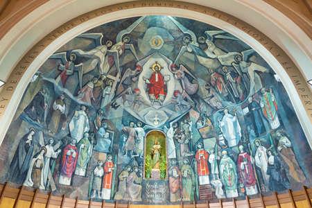 BARCELONA, SPAIN - MARCH 5, 2020: The modern fresco of Jesus among the saints in the church Santuario Maria Auxiliadora i Sant Josep by Fidel Trias Pages and Raimon Roca (1966).