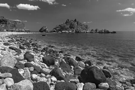 Taormina - The beautifull little island Isola Bella and the beach with the  pumice stones. Stockfoto - 150296369