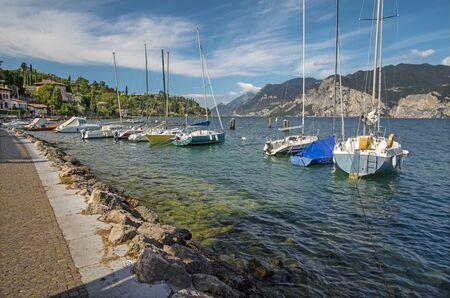 Malcesine - The promenade of Lago di Garda with the boats in the morning.