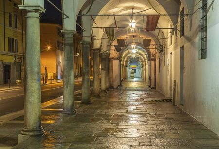 Parma - The porticoes of State archive building at night. Stock Photo