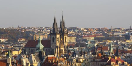 Prague - The panorama of Town and the church of Our Lady before Týn in the evening light.