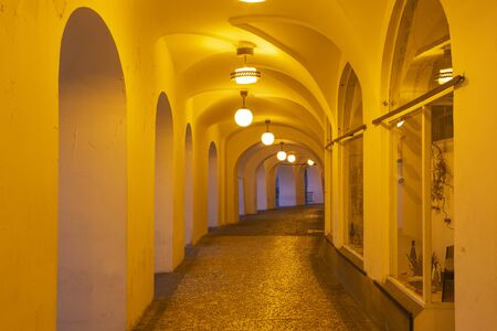 Prague - The porticoes on Old Town quarter at night. Фото со стока