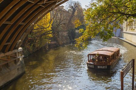 PRAGUE, CZECH REPUBLIC - OCTOBER 13, 2018: The little ship with the tourists on the canal in the Little Quarter.