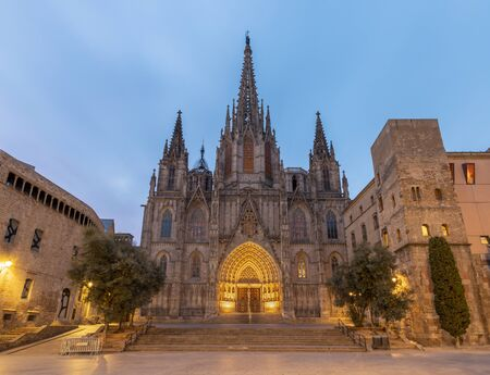 Barcelona - The facade of old gothic cathedral of the Holy Cross and Saint Eulalia at dusk. Standard-Bild