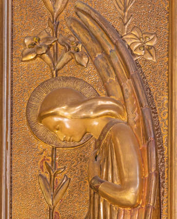 BARCELONA, SPAIN - MARCH 5, 2020: The modern relief of archangel Gabriel in the church Església de la Concepció from 20. cent.
