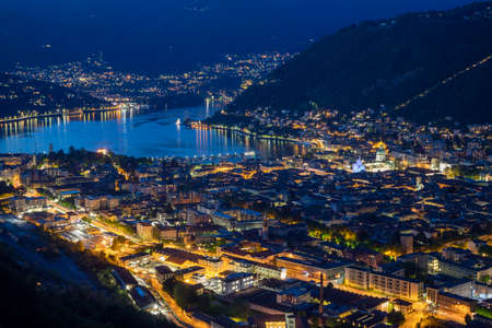 Como - The panorama of the city and lake Como at dusk. Archivio Fotografico