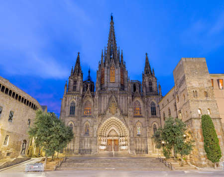 Barcelona - The facade of old gothic cathedral of the Holy Cross and Saint Eulalia at dusk. Archivio Fotografico