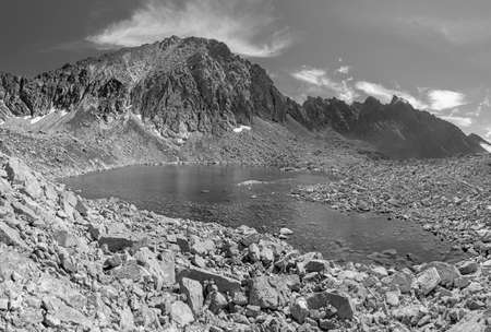 High Tatras - Slovakia - The the look to Capie pleso lake with the peaks Strbsky stit and Satan. Archivio Fotografico