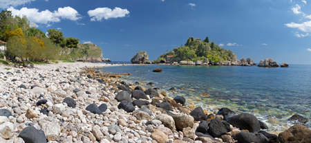 Taormina - The beautifull little island Isola Bella and the beach with the  pumice stones.
