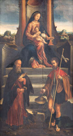 FERRARA, ITALY - JANUARY 30, 2020: The  painting of Madonna with the sains Jerome and James in church Chiesa di Santa Maria in Vado by Stefano Falzagallon (16. cent.).