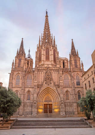 Barcelona - The facade of old gothic cathedral of the Holy Cross and Saint Eulalia at dusk. Editoriali