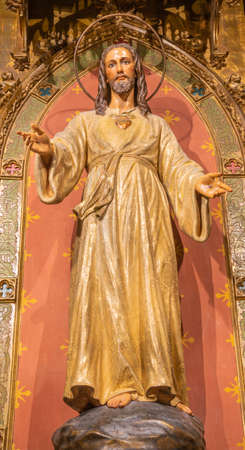 BARCELONA, SPAIN - MARCH 3, 2020: The carved polychrome statue of Heart of Jesus in the chruch Iglesia Sant Ramon De Penyafort. Editoriali