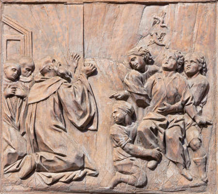 CATANIA, ITALY - APRIL 7, 2018: The baroque carved relief from live of St. Benedict (healing of a boy of leprosy) on the gate of church Chiesa di San Benedetto.