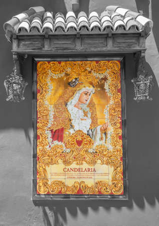 CORDOBA, SPAIN - MAY 26, 2015: The ceramic tiled cryed Madonna on the Compas de San Francisco square by C. J. Soriano (2007).