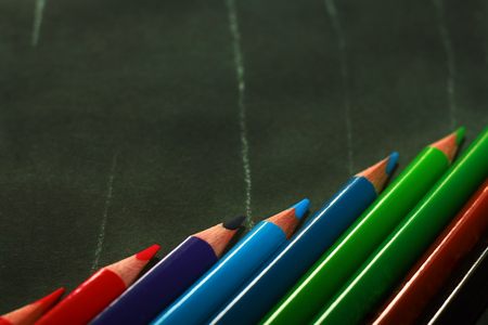 Photo of crayons on black backdrop