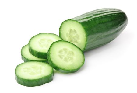 Cucumber and slices isolated over white background. photo