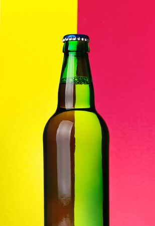 Beer bottle on red and yellow background